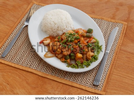 Natural light photo of stewed seafood with vegetables and steamed rice top view 2 - stock photo