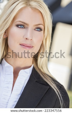 Natural light portrait of a beautiful woman or businesswoman with blond hair and blue eyes