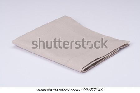 Natural Linen Napkin On White Background - stock photo