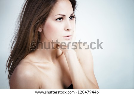 natural looking young woman portrait studio shot - stock photo