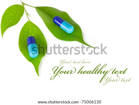 natural medical pills with green leaves. isolated on white background - stock photo