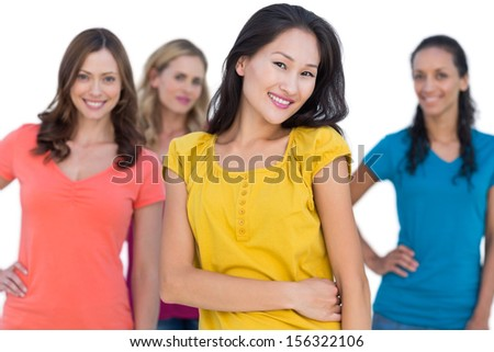 Natural models posing  on white background with elegant brunette on foreground hands on hips