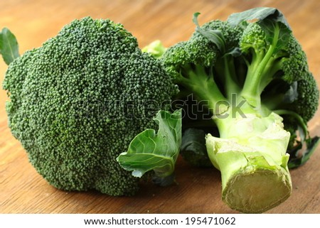 Natural organic broccoli on a wooden table - stock photo