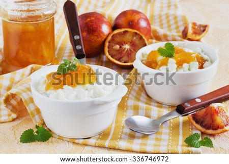 natural organic cottage cheese with orange jam in a bowl on the table. healthy eating concept. selective focus - stock photo