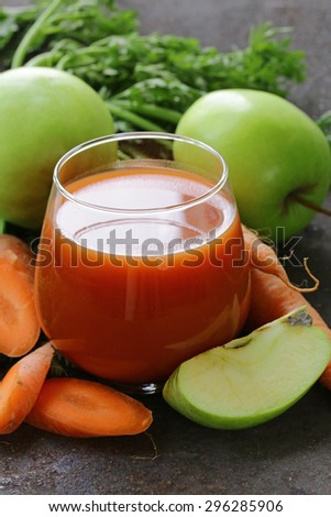 natural organic fresh juice of carrots and green apple - healthy eating - stock photo