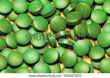 Natural Organic Green Algae Spirulina Pills - stock photo