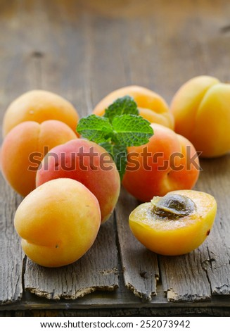 natural organic ripe apricots on a wooden table - stock photo