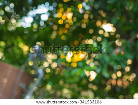 Natural outdoors bokeh in green and yellow tones. - stock photo