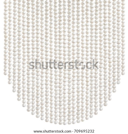 Natural pale pearl beads (necklace) hanging in a parabola shape, isolated on white