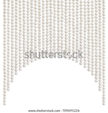 Natural pale pearl beads (necklace) hanging in a shape of an arch, isolated on white
