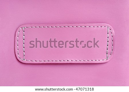 Natural pink leather background closeup - stock photo