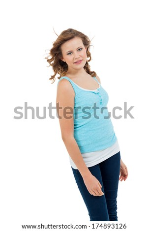 Natural portrait of a pretty young woman with long tousled hair and a sincere gentle expression, head and shoulders isolated on white - stock photo