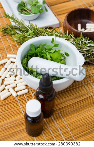 Natural products for aromatherapy on placemat - stock photo