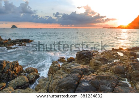 Natural rock with strong water wave and sunrise background at Belanak Beach, Lombok, Indonesia - stock photo
