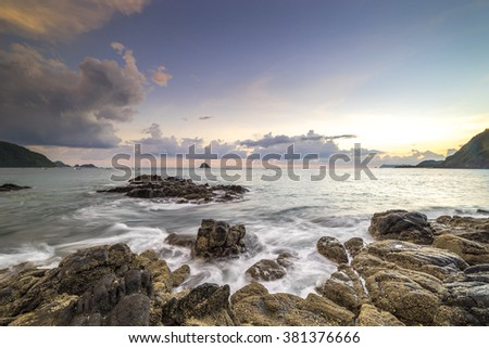 Natural rock with strong water wave and sunrise background at Belanak Beach, Lombok, Indonesia