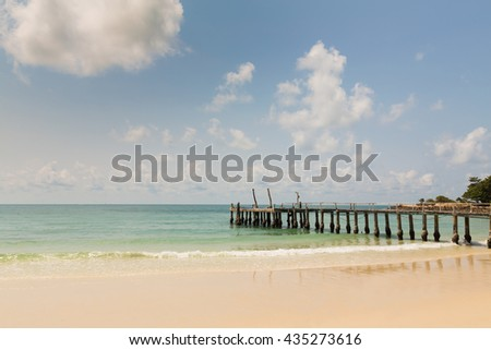 Natural sand beach and fishing jetty footbridge, natural landscape background