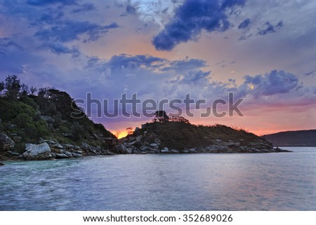 Natural seascape near Quarantine station on North Head of Sydney Harbour at sunset.  - stock photo
