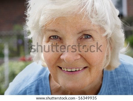 Natural senior woman portrait, outdoor - stock photo