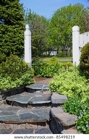 Natural slate used in construction of steps in a home garden. - stock photo