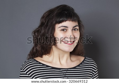 natural smile - 20s brunette woman with natural smile expressing joy and wellbeing,studio shot - stock photo