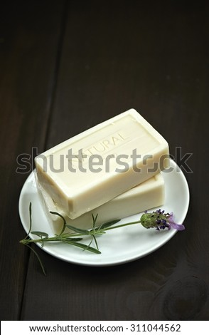 Natural soap bars over dark wooden background. Spa concept. - stock photo
