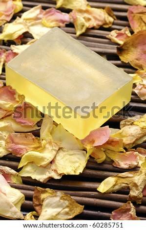 Natural soap with rose petals don mat - stock photo