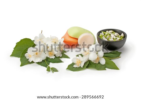 natural soap with the scent jasmine and jasmine flowers isolated on white background - stock photo