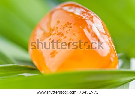 natural stone carnelian in beautiful colors on white ground - stock photo