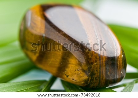 natural stone tiger iron in beautiful colors on white ground - stock photo