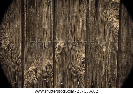 Natural texture backdrop of old retro vintage aged brown wooden board plank table or wall house fence floor background with dark frame in angle Metal nails hammered Empty copy space for inscription - stock photo