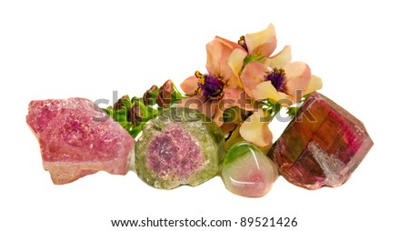 Natural tourmaline gem stones and mullein (verbascum) blossoms - stock photo