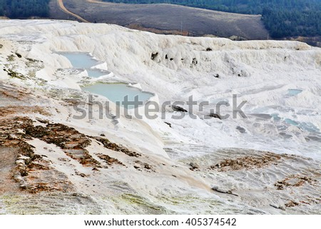 Natural turquoise pool and limestone terraces at ancient Hierapolis, or Pamukkale, Turkey - stock photo