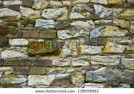 natural wall full of many stones and bricks - stock photo