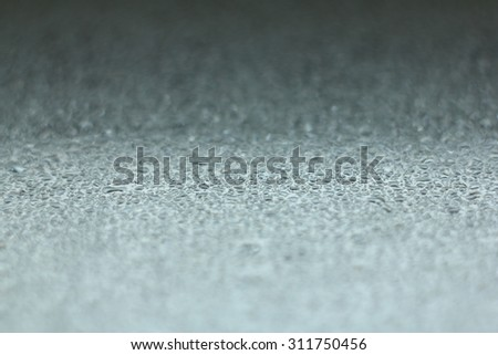 Natural water drop on glass. Abstract background, selective focus. - stock photo
