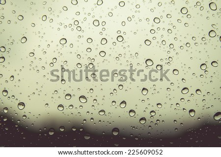Natural water drops on gray window glass background - stock photo