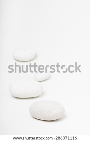 natural white pebbles on white background