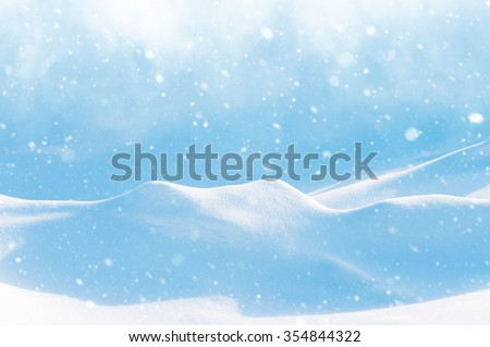 Natural winter background with snow drifts and falling snow - stock photo
