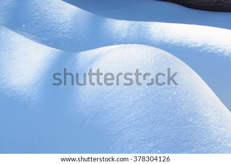 Natural winter with snow shiny drifts