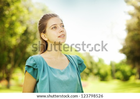 natural woman in the garden (soft focus on her eye) - stock photo