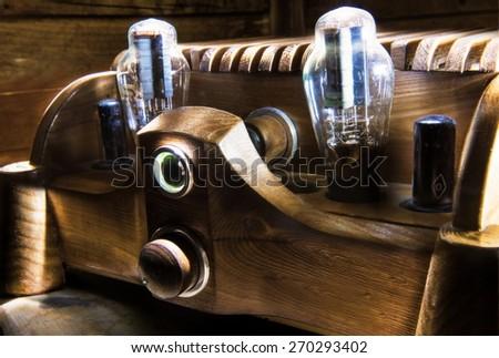 Natural wood tube amplifier - locust tree body - stock photo