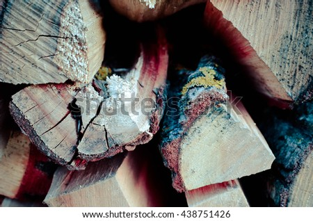 Natural wooden background - closeup of chopped firewood. Firewood stacked and prepared for winter Pile of wood logs - stock photo