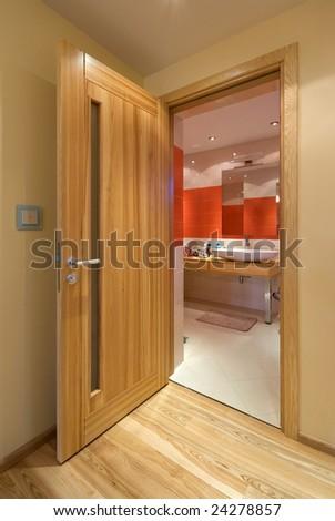 Natural wooden doors to bathroom - stock photo