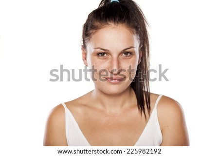 Natural young woman with a fake smile - stock photo