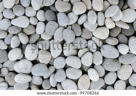 Naturally polished white rock pebbles background - stock photo