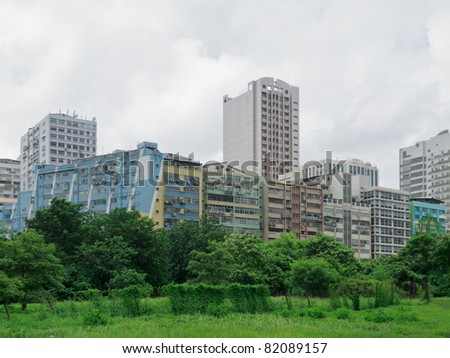 Nature against industrial building, with pollution concept - stock photo
