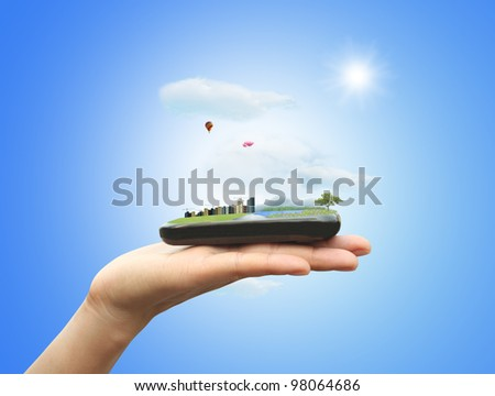 Nature and city on mobile phone - stock photo