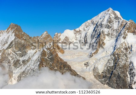 Nature and mountaineering. View on height mountains peak - stock photo