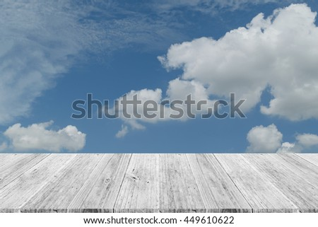 Nature cloudscape with blue sky and white cloud with Wood terrace - stock photo
