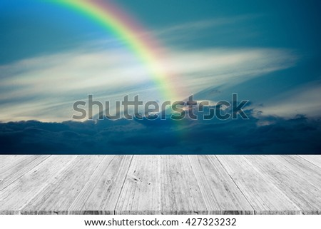Nature cloudscape with blue sky and white cloud with Wood terrace and rainbow , process in vintage style - stock photo
