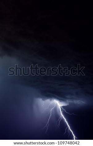 Nature force background - lightning in storm sky with dark clouds and rain - stock photo